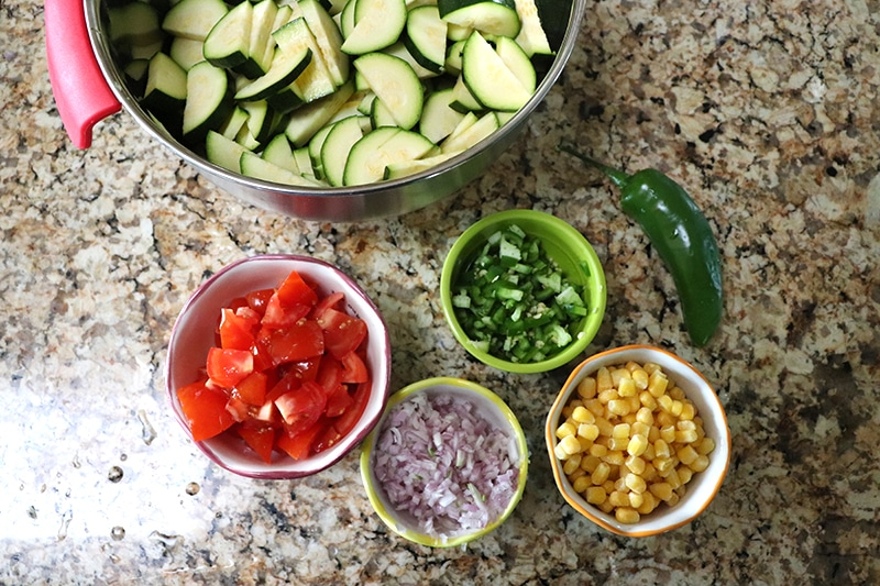 Diced zucchini, diced roma tomatoes, diced jalapenos, diced shallots, corn, and a whole jalapeno