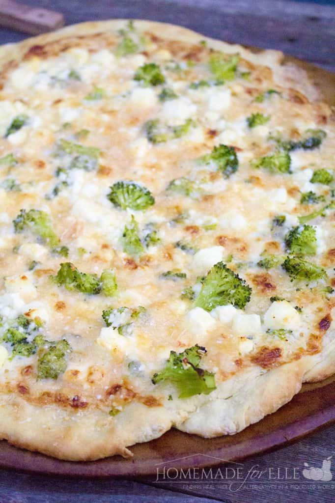 Broccoli, feta and alfredo pizza