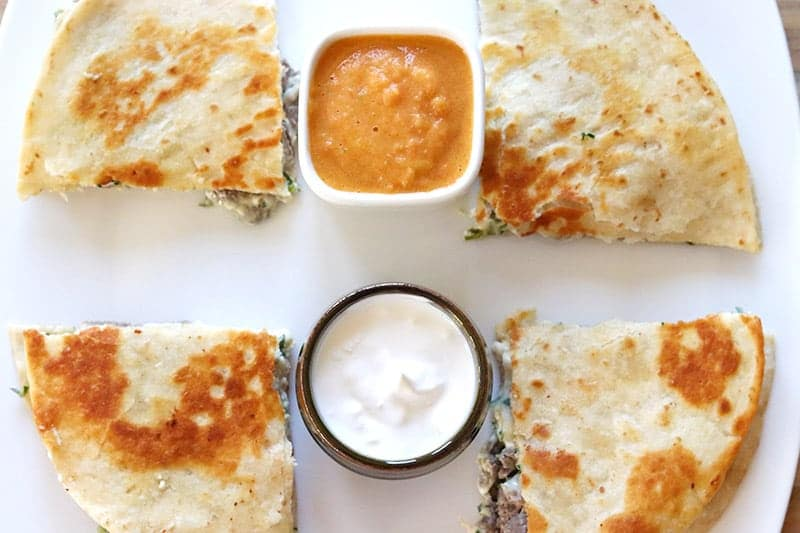 Salsa and cream cheese with steak quesadillas
