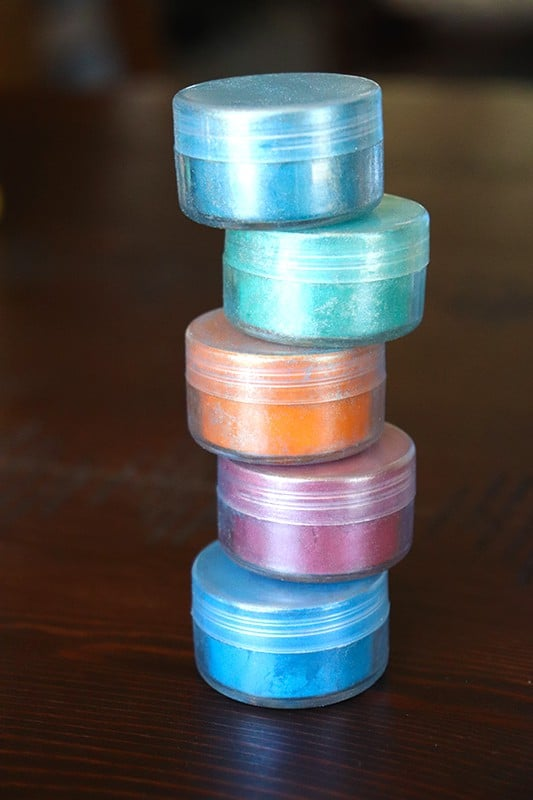 Blue, purple, orange, and teal natural coloring pigment for homemade bath bombs