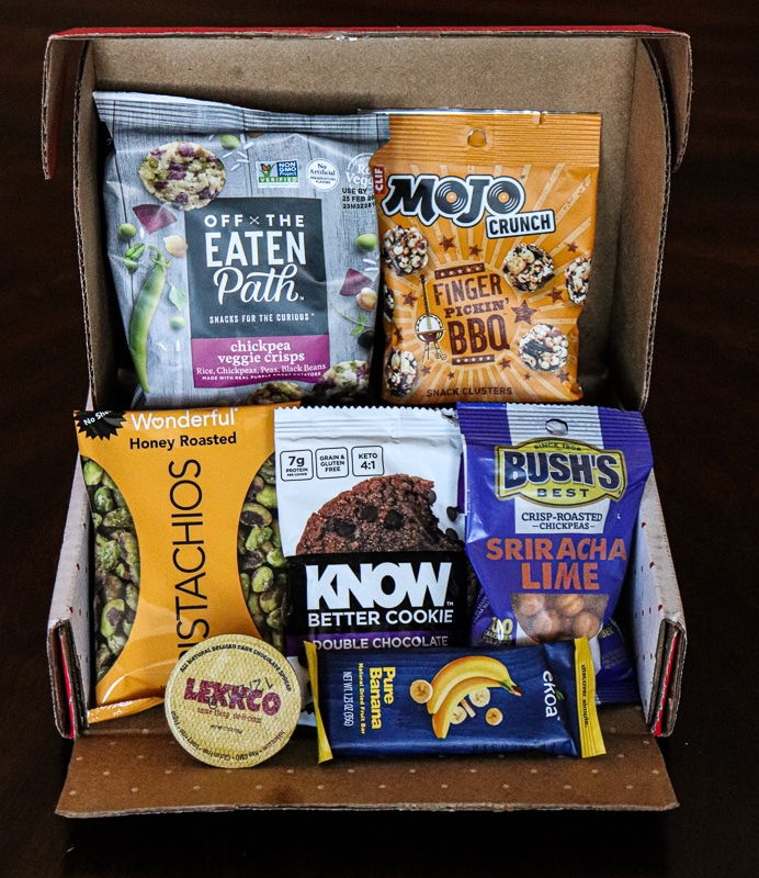 Inside the Love with Food Tasting Box with 7+ healthy clean eating snacks.
